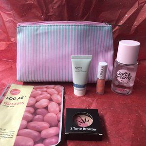 Striped Clinique Bag w/ mixed beauty products